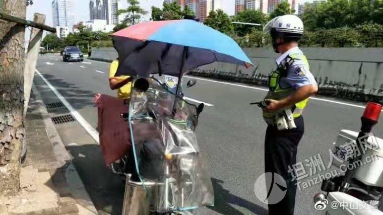 """坦洲街坊还装遮阳伞能遮风挡雨?这是一把""""夺命伞""""!中山交警开始整治了"""